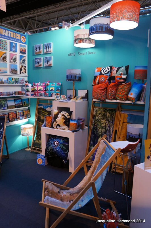 Life s a beach deckchair and seaside lampshade in the entrance to contemporary home and gifts for Stand expo deco